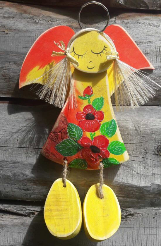 drewniany aniołek mniszek żółty